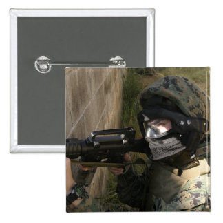 A Marine provides security 2 Inch Square Button