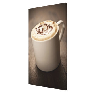 A mug of Cappuccino coffee topped with melted Canvas Print