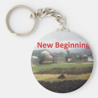 A new beginning basic round button keychain