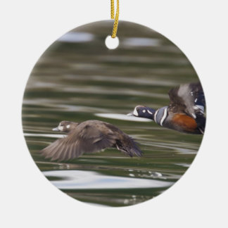 A pair of harlequin ducks take flight ceramic ornament