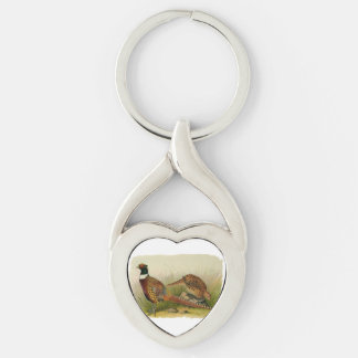 A pair of Ring necked pheasants in a grassy field Silver-Colored Twisted Heart Keychain