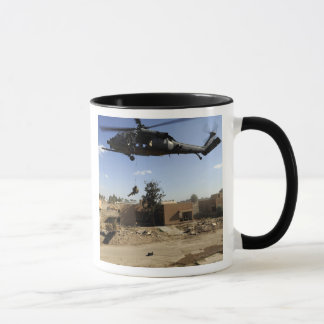 A pararescueman rappels from an HH-60 2 Mug