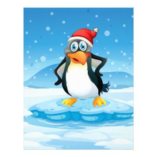 A penguin wearing Santa's hat standing above an ic Custom Letterhead