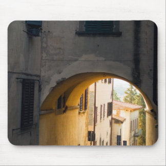A person walking under an arch, down a hill in mouse pad