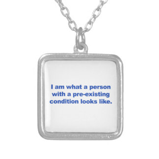 A person with a pre-existing condition silver plated necklace