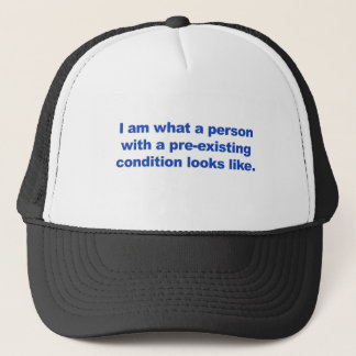 A person with a pre-existing condition trucker hat