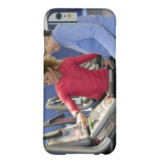 A personal trainer helps a senior woman on a barely there iPhone 6 case