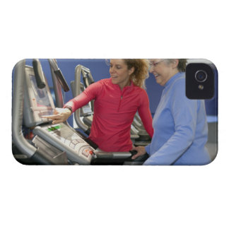 A personal trainer helps a senior woman on a iPhone 4 case