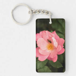 A pink rose and the fly insect keychain