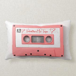 A pink vintage audio cassette tape lumbar pillow