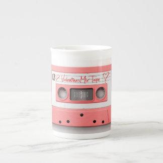 A pink vintage audio cassette tape tea cup