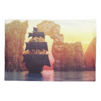 A pirate ship off an island at a sunset pillowcase