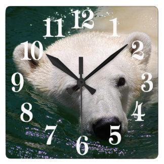 A polar bear just chilling square wall clock