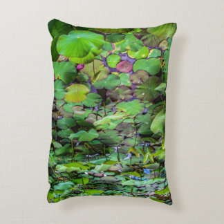A pretty pond full of lily pads at a water temple decorative pillow