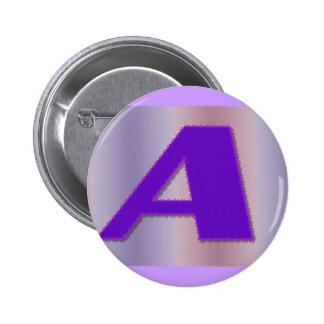 A purple mongram 2 inch round button