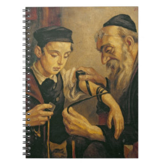 A Rabbi tying the Phylacteries to the arm of a boy Notebooks