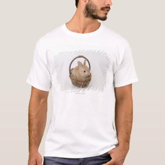 A rabbit is in a basket.Netherland Dwarf. T-Shirt