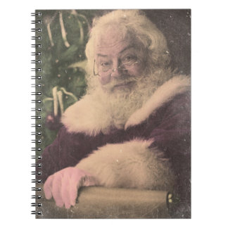 A Real Vintage Santa Claus checking out his list Notebook