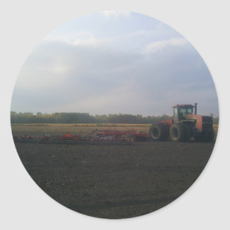 A Red Tractor Resting On The Open Fields... Classic Round Sticker