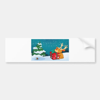 A reindeer holding a red gift near the pine tree bumper sticker