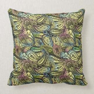 A repeating pattern of random paislies throw pillow