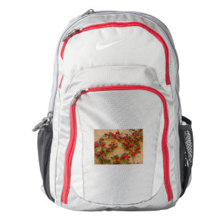 a roses climb on a brick wall on nike backpack