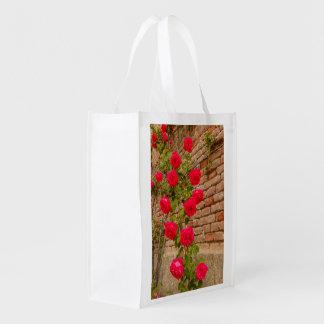 a roses climb on a brick wall on reusable bag reusable grocery bags