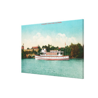 A Sacramento River Scene with a Riverboat Canvas Print