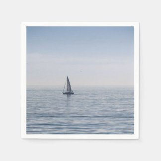 A sailboat on a calm sea paper napkins