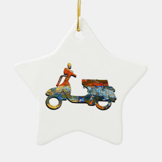 A SCOOTING ALONG CERAMIC ORNAMENT