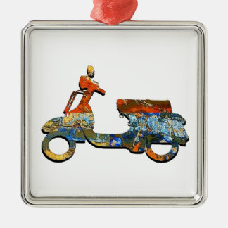 A SCOOTING ALONG METAL ORNAMENT