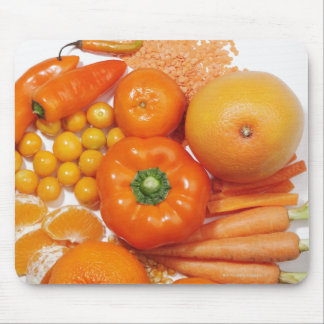 A selection of orange fruits & vegetables. mouse pad