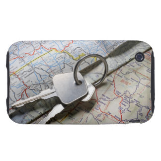 A set of car keys on a pile of road maps. tough iPhone 3 cases
