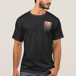 A shirt with a photo of the sea during sun set