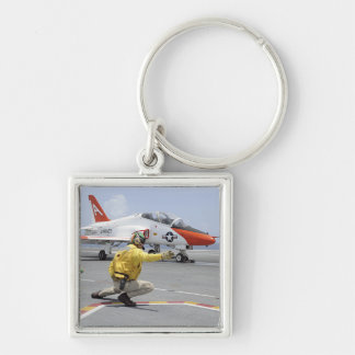 A shooter aboard the aircraft carrier key chains