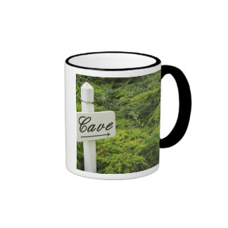 A sign pointing tho the wine cellar (Cave) in Ringer Coffee Mug