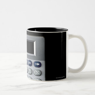 A silver calculator Two-Tone coffee mug