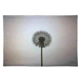 A Single Dandelion Against a White Backdrop Placemat