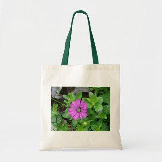 A single purple dalia bag