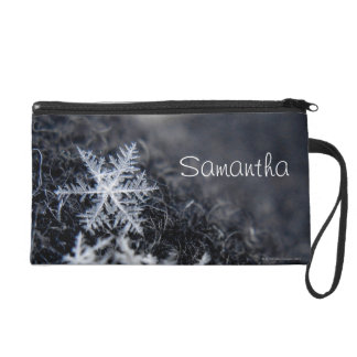 A single snowflake on stands out wristlet clutches