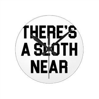 A Sloth Near Round Clock