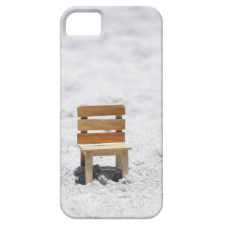 A small chair in the sandy beach case for the iPhone 5
