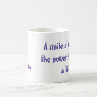 A smile always has the power to change a life. coffee mug