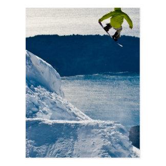 A snowboarder jumping postcard
