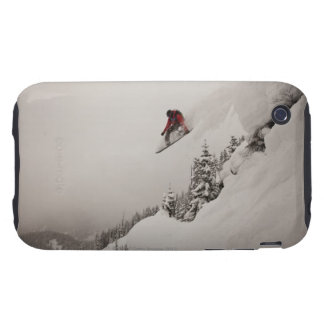 A snowboarder jumps off a cliff into powder in tough iPhone 3 cover