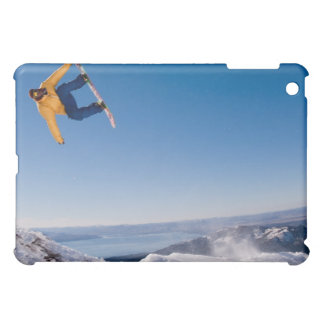 A snowboarder spins off a jump in Argentina iPad Mini Cases