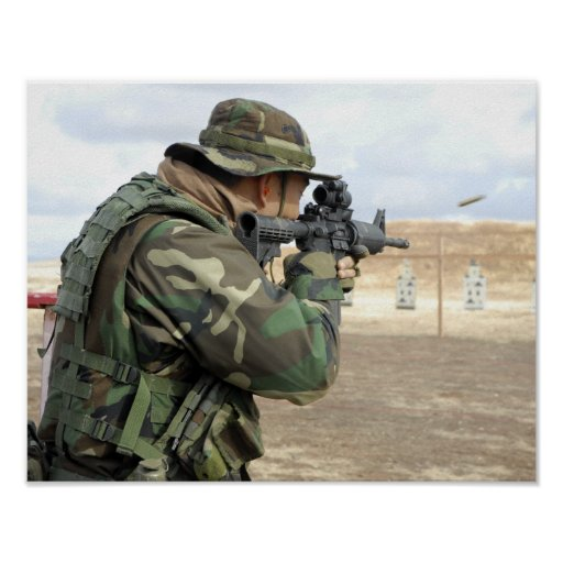 A soldier fires rounds down range print