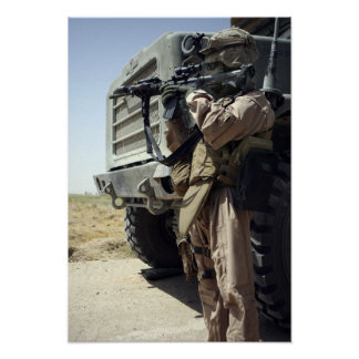 A soldier provides security for Marines Posters