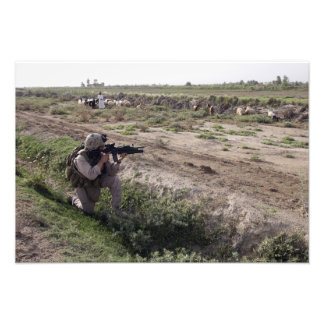 A soldier scans the distance photograph