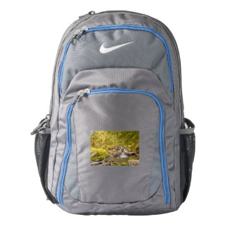 a sparkling jump of a waterfall   nike backpack
